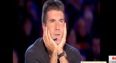 Simon listening to Susan Boyle singing